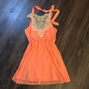 Lace and lightweight coral dress
